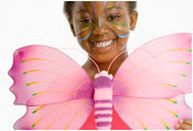 child with face painting and costume to look like a butterfly