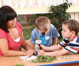 Teacher doing science exploration with two students