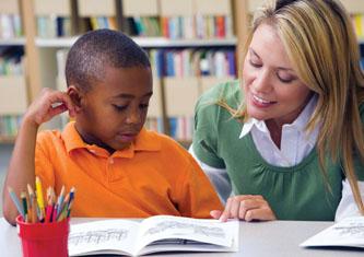 A teacher offering homework help to a student
