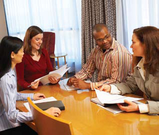 Photo of a school staff discussing issues.