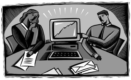 Image of two office workers looking at a computer screen displaying a chart.