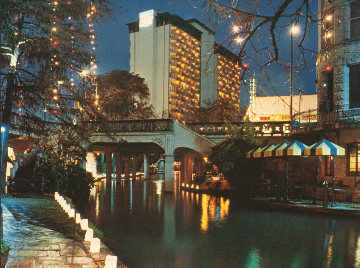 A photo of the San Antonio riverwalk at night.