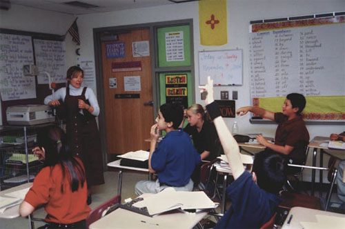 Photo of Bernalillo literacy coach Jody Marinucci models a lesson for one of the middle school teachers.