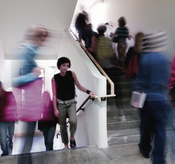 Students walking to class in a stairwell.