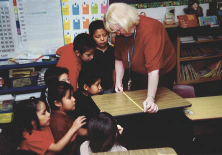 Algodones Elementary School teacher Bobbie Stratton shows her class at how to read a tape measure.