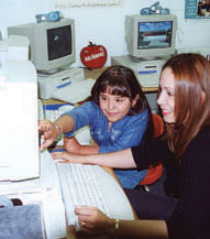 Girl working on computer with lady