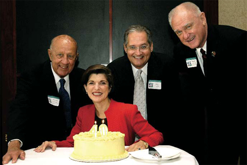 Wayne Holtzman, Luci Baines Johnson, Wes Hoover, and Preston Kronkosky celebrate SEDL's 40th anniversary