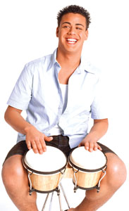 A photo of a man playing the drums.
