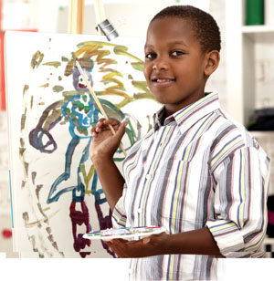 A photo of a boy painting.