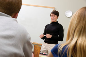 A teacher talks to staff during a professional development session.