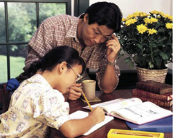 photo of a father and daughter studying