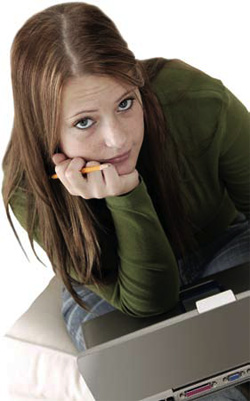photo of a girl using a laptop computer