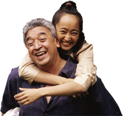photo of a father giving daughter a piggyback ride
