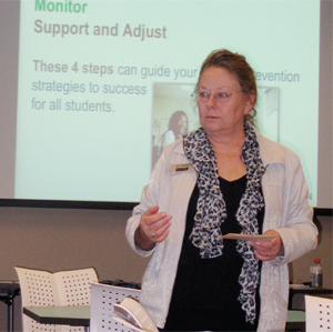 Photo of Ann Neeley showing Texas educators how to use student data.