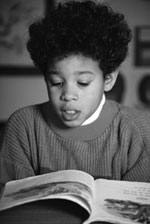 Picture of young boy reading